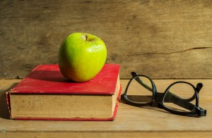 Antique book with apple