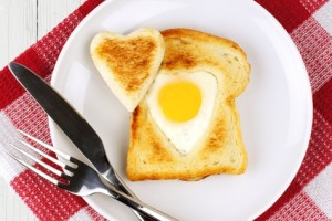 Heart shaped egg in toast for Valentines Day with checked cloth